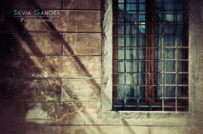 Window with long shadows - ©Silvia Ganora - All rights reserved.