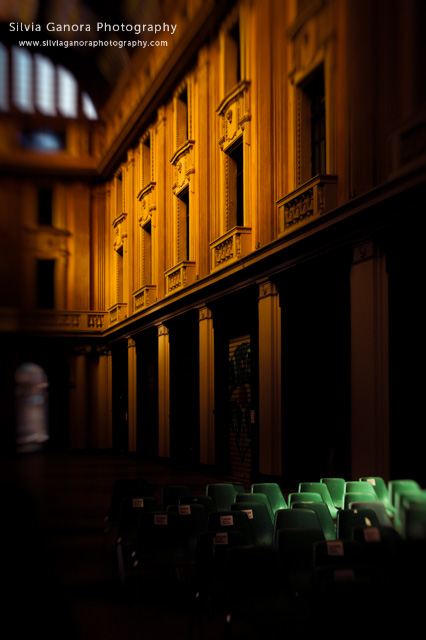 Gallery interior with moody light and green chairs - ©Silvia Ganora Photography - All Rights Reserved