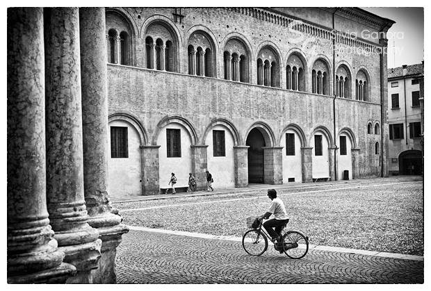 Shot in Parma. Two ladies walking and one biking