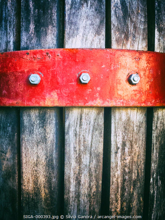 Closeup shot of an old barrel with metal plaque and bolts - ©Silvia Ganora Photography - All Rights Reserved