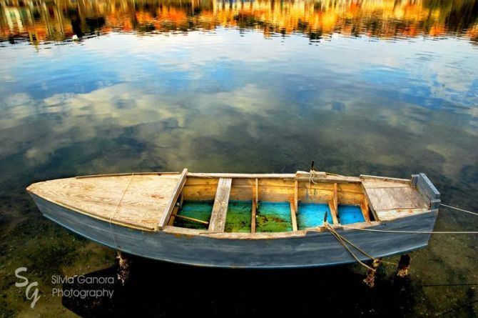 Old boat on a lake with fall colors and reflections in the water - - ©Silvia Ganora Photography - All Rights Reserved