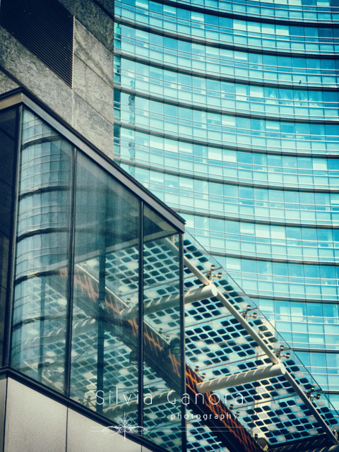 Abstract shot of modern buildings with skyscraper facade in the background- ©Silvia Ganora Photography - All Rights Reserved