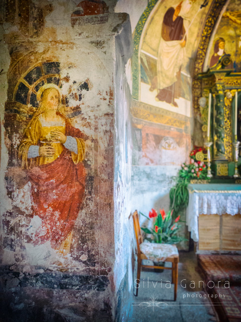 Interior of Italian church with paintings on decayed wall and chair near altar in the background- ©Silvia Ganora Photography - All Rights Reserved