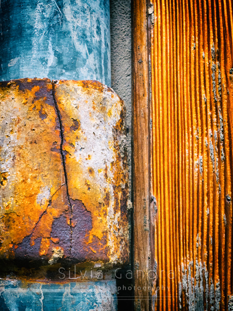 Closeup shot of a rusty gutter close to a rotten wooden door- ©Silvia Ganora Photography - All Rights Reserved