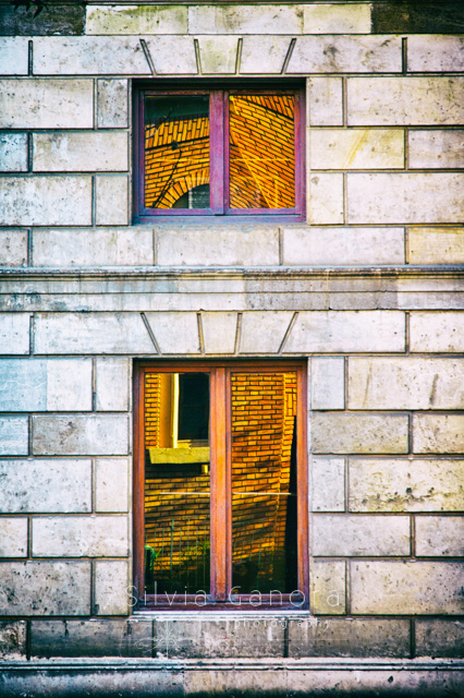 Distorted reflections of buildings in windows panes on a house facade- ©Silvia Ganora Photography - All Rights Reserved