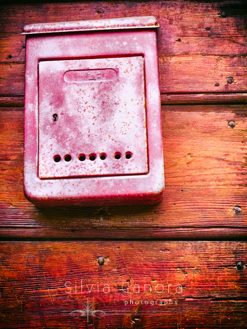 Rotten metal mailbox on a wooden door- ©Silvia Ganora Photography - All Rights Reserved