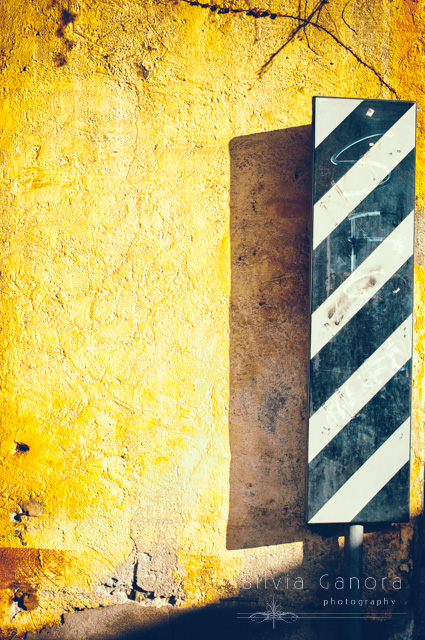 Street sign against wall- ©Silvia Ganora Photography - All Rights Reserved