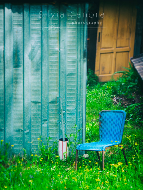 Abandoned blue plastic chair near a shack- ©Silvia Ganora Photography - All Rights Reserved