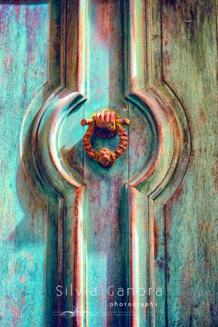 Hand shaped doorknob on a weathered wooden door- ©Silvia Ganora Photography - All Rights Reserved