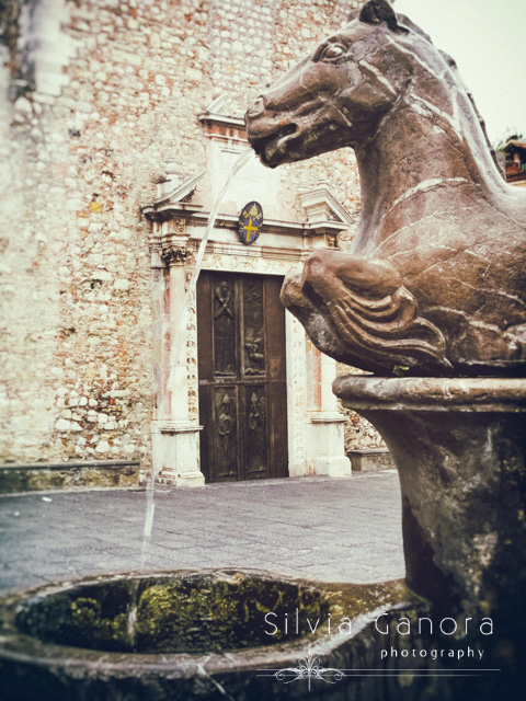 Beautiful fountain in Taormina, Sicily, with part of the Cathedral facade in the background. Vintage feel.- ©Silvia Ganora Photography - All Rights Reserved