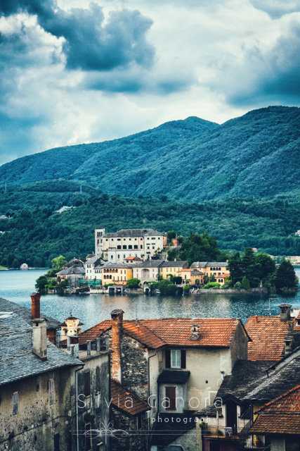 View over San Giulio island in Lake Orta, Italy. The tiny island has an ancient  Benedictine monastery.- ©Silvia Ganora Photography - All Rights Reserved
