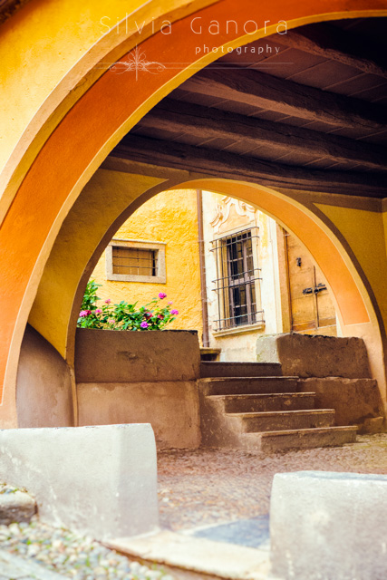 Arched passageway with vase of flowers and steps- ©Silvia Ganora Photography - All Rights Reserved