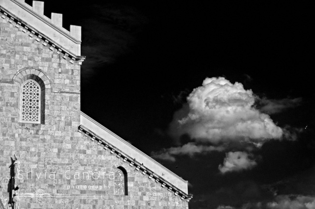 Black and white shot of a detail of the cathedral in Messina, Sicily, with cloud in the background- ©Silvia Ganora Photography - All Rights Reserved