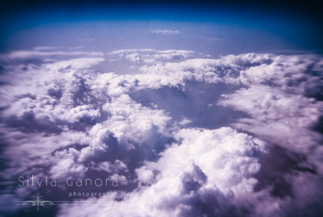Blanket of clouds as seen from airplane with blue sky above- ©Silvia Ganora Photography - All Rights Reserved