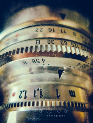 Detail of a vintage camera lens with f stops and metering scale- ©Silvia Ganora Photography - All Rights Reserved