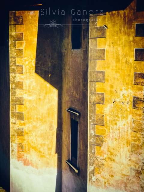 Detail of a n old church wall with windows and shadow- ©Silvia Ganora Photography - All Rights Reserved