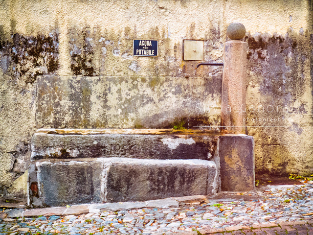 Old stone fountain in Italian village.- ©Silvia Ganora Photography - All Rights Reserved