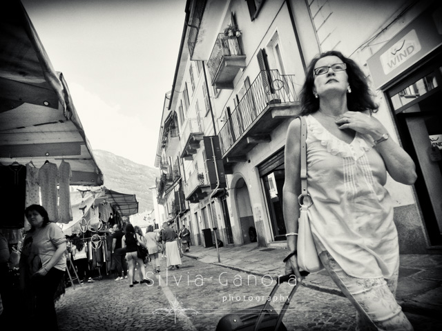 Black and white street shot of a woman with trolley - ©Silvia Ganora - All Rights Reserved