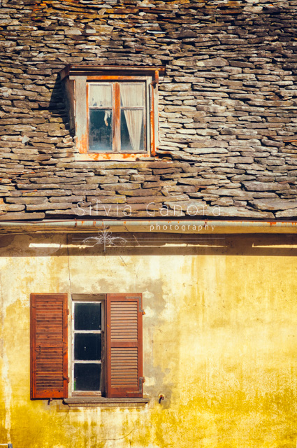 Two decayed windows. One on the attic. Roof made of stone tiles.- ©Silvia Ganora Photography - All Rights Reserved
