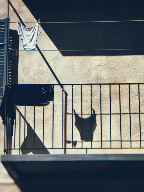 Underpants hanging to dry on a balcony with shadows- ©Silvia Ganora Photography - All Rights Reserved