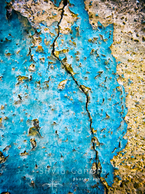 Closeup shot of a long crack in a decayed blue wall- ©Silvia Ganora Photography - All Rights Reserved