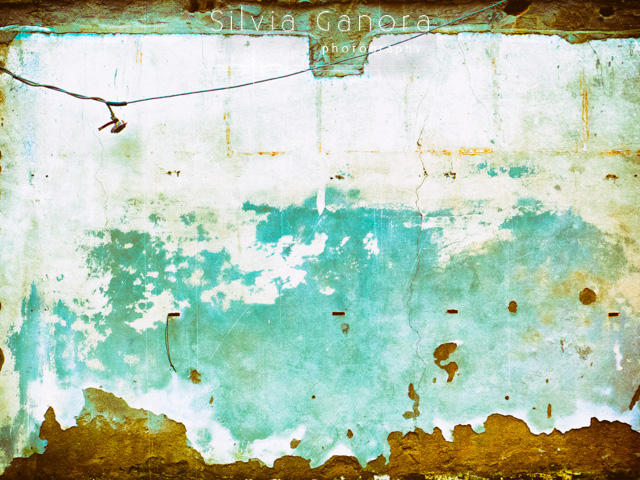 Abstract shot of a decayed wall with hanging electric wire and plug- ©Silvia Ganora Photography - All Rights Reserved