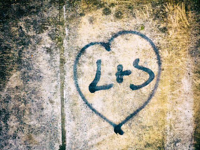 Graffiti on a decayed wall representing a heart with initials in it.- ©Silvia Ganora Photography - All Rights Reserved