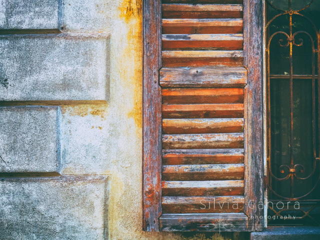 Old rotten shutter on decayed window - Copyright Silvia Ganora Photography