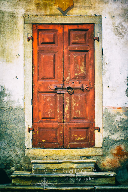 Old wooden door with iron lock and steps - Copyright Silvia Ganora Photography