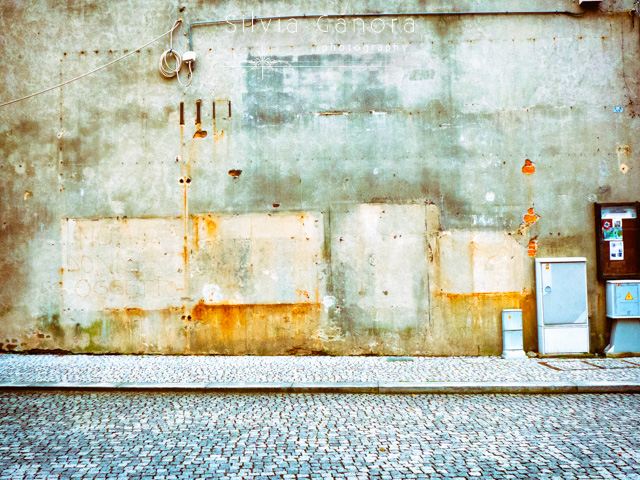 Decayed wall with electric wire and cobbled sidewalk- ©Silvia Ganora Photography - All Rights Reserved