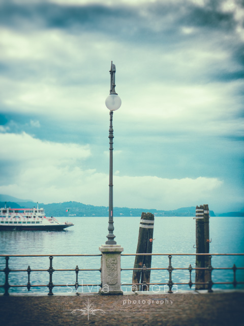 Ferryboat on Lake Maggiore,Italy, on a cloudy day. Streetlamp in the foreground- ©Silvia Ganora Photography - All Rights Reserved