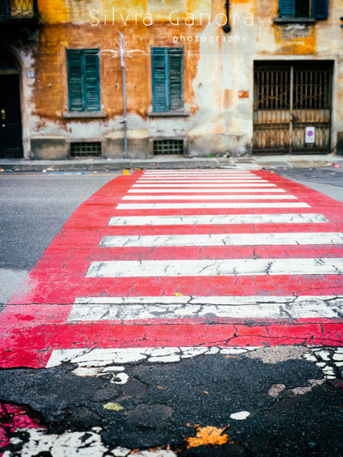 Italian crosswalk leading to a decayed old house facade in the distance- ©Silvia Ganora Photography - All Rights Reserved