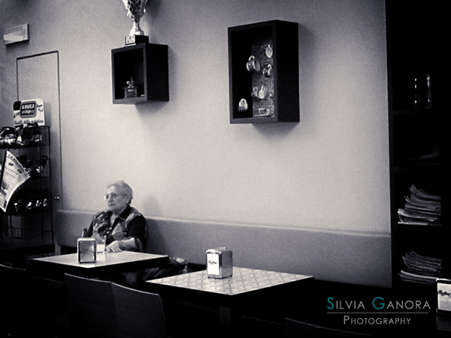 Old woman at a table in a café - ©Silvia Ganora Photography - All Rights Reserved
