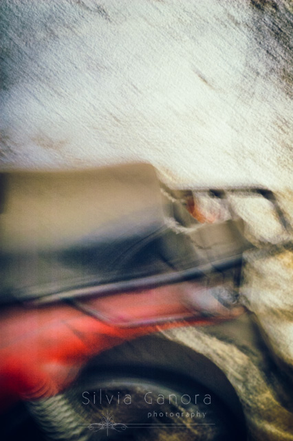 Old and dusty motorbike detail against wall with motion blur - Copyright Silvia Ganora Photography