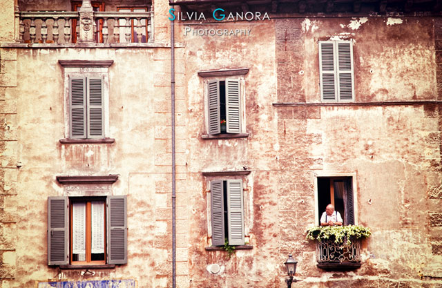 Old man looking out a window in an old Italian house- ©Silvia Ganora Photography - All Rights Reserved