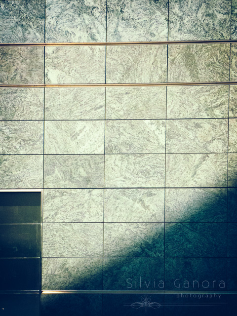 Modern marble wall with shadow and door- ©Silvia Ganora Photography - All Rights Reserved