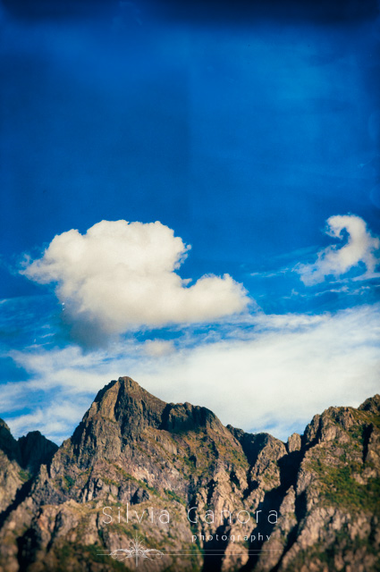 Alps mountaintops with clouds in a blue sky - ©Silvia Ganora Photography - All Rights Reserved