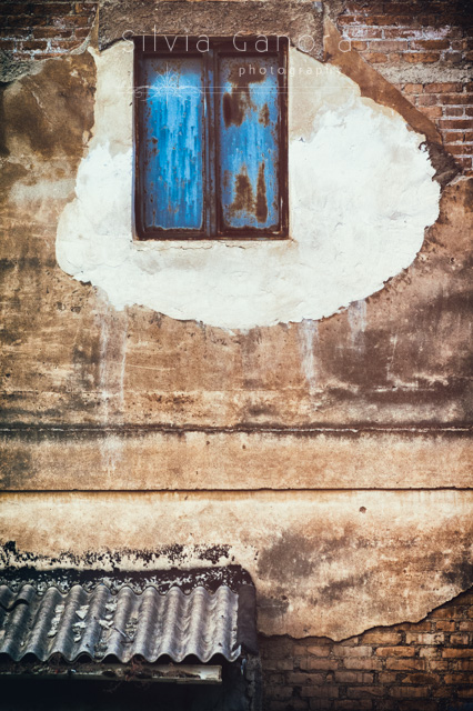Rotten closed window on a decayed wall with roofing - ©Silvia Ganora Photography - All Rights Reserved