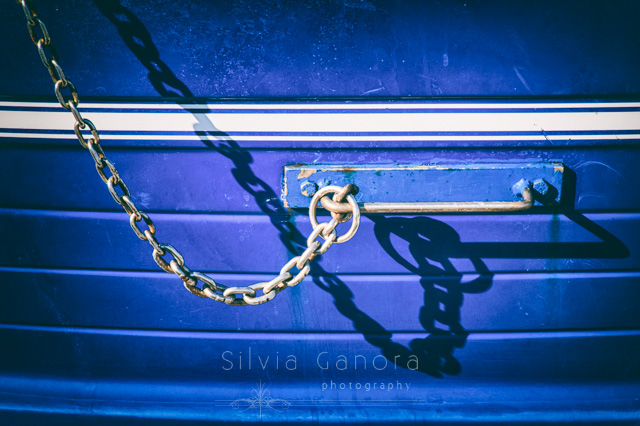 Chain and handle detail on a blue boat - ©Silvia Ganora Photography - All Rights Reserved