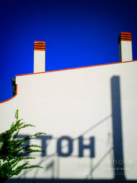 White building wall with shadow of hotel sign - ©Silvia Ganora Photography - All Rights Reserved