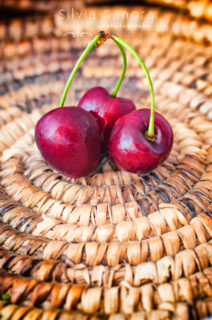 Three cherries in a wicker basket - ©Silvia Ganora Photography - All Rights Reserved