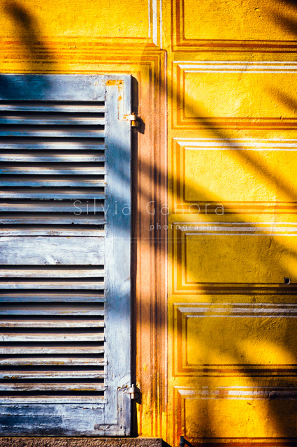 Abstract shot of a shutter and ornate wall with shadow - ©Silvia Ganora Photography - All Rights Reserved