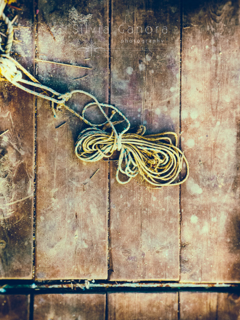 Rope on an old boat's wooden floor - ©Silvia Ganora Photography - All Rights Reserved