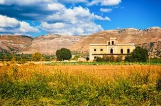 Old Sicilian mansion with fields and mountains with clouds. - ©Silvia Ganora Photography - All Rights Reserved