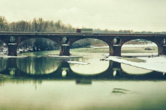 Wintry shot of a sonte bridge with snow and passing truck - ©Silvia Ganora Photography - All Rights Reserved