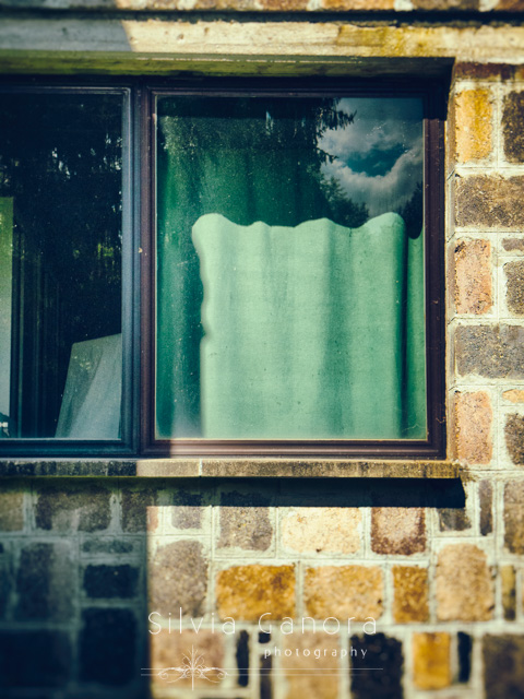 Modern window with green curtain and reflection of clouds©Silvia Ganora Photography - All rights reserved