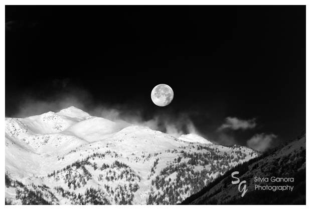 Black and white shot of a full moon on snow capped Alps©Silvia Ganora Photography - All rights reserved