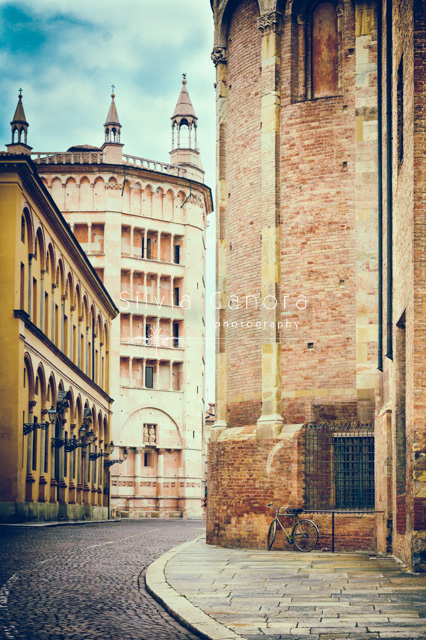 Baptistery in the city of Parma with empty road and bicycle - ©Silvia Ganora Photography - All rights reserved