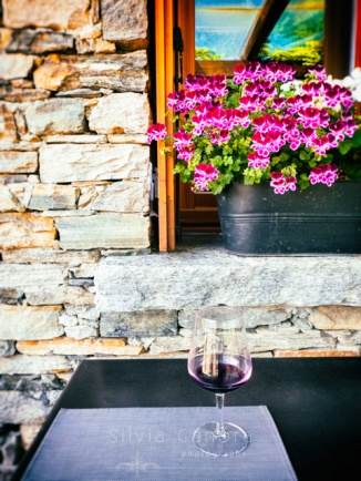 Glass of wine with flowers -