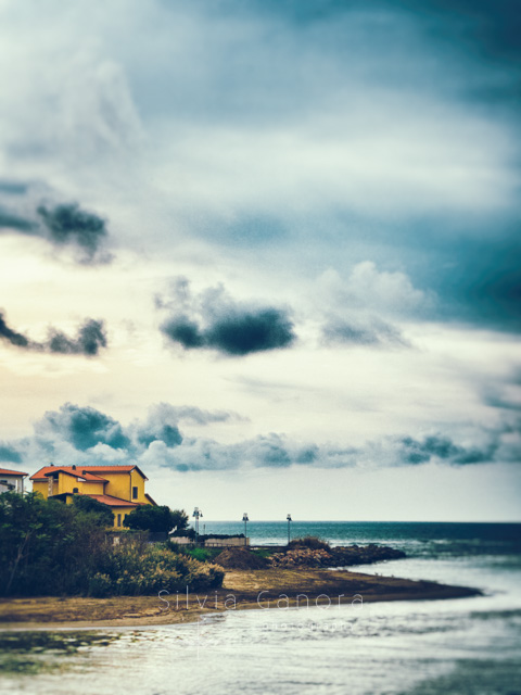 House on the sea with dramatic sky -